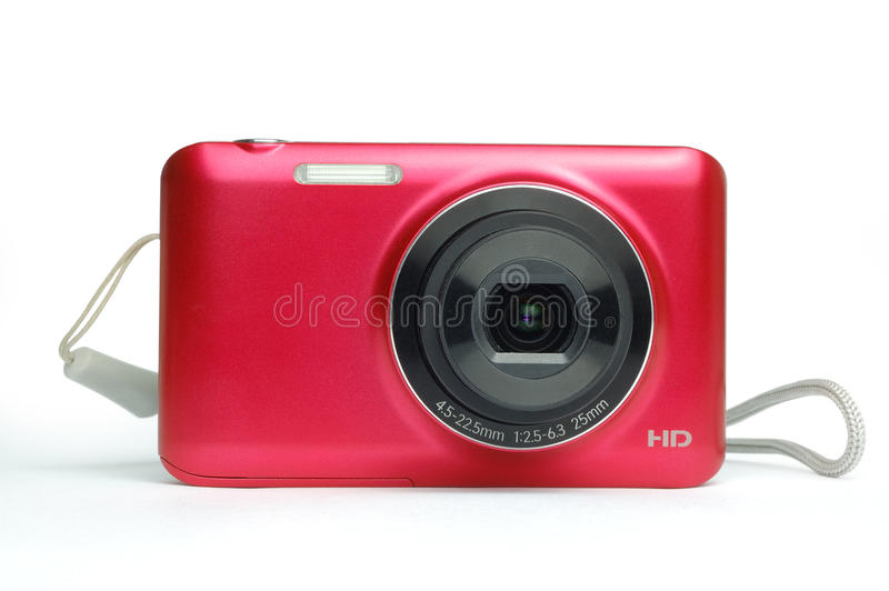 Digital compact camera. Red compact camera isolated on white background royalty free stock images
