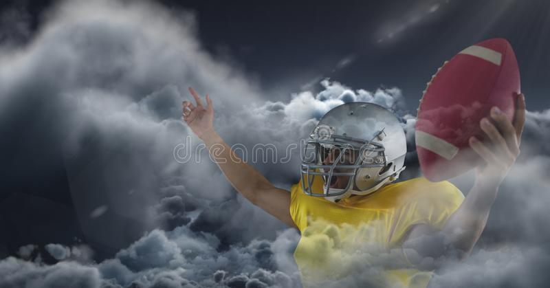 American football player in clouds. Digital composite of american football player in clouds stock photos