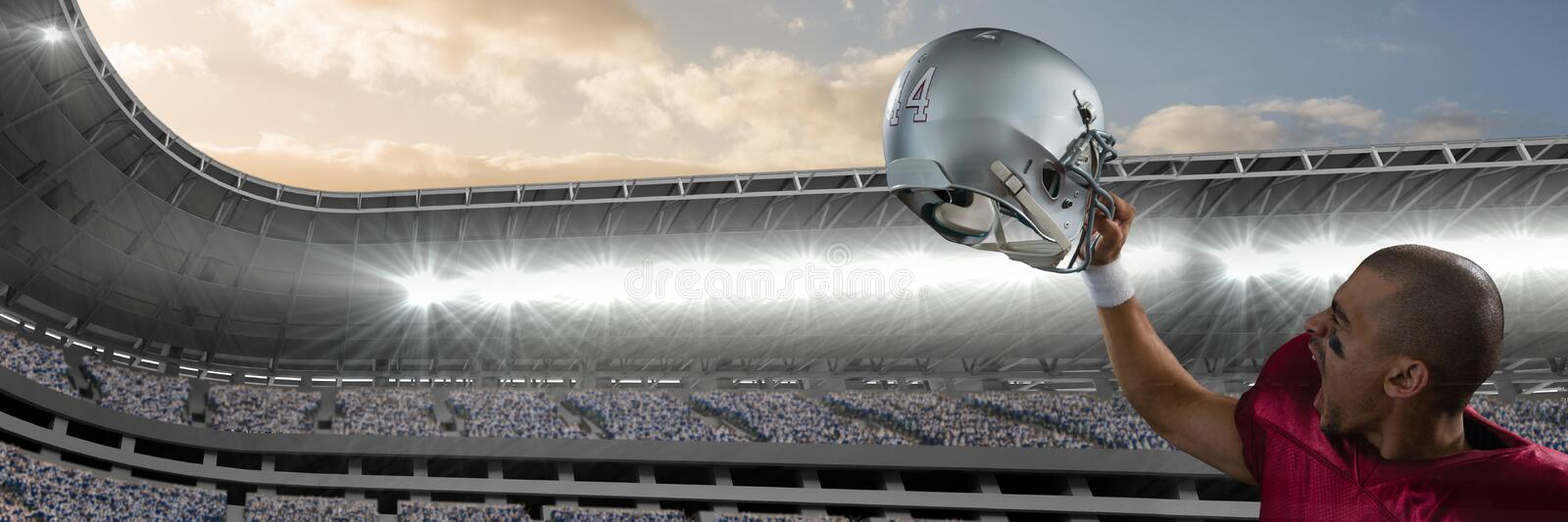 american football player holding up helmet royalty free stock photo