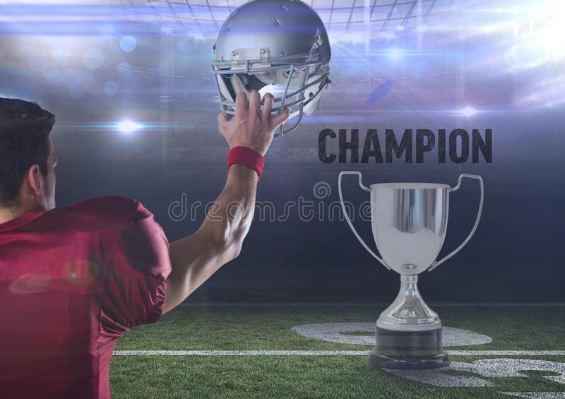 American football player holding up helmet with throphy and text. Digital composite of american football player holding up helmet with throphy and text royalty free stock image