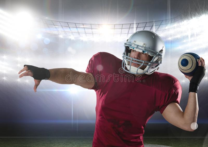 american football player standing in stadium throwing the ball royalty free stock image