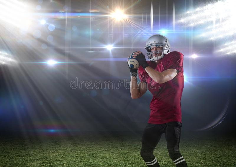 american football player standing in stadium throwing the ball royalty free stock photo