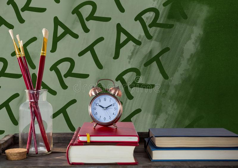Art text on blackboard with books and paintbrushes royalty free stock image