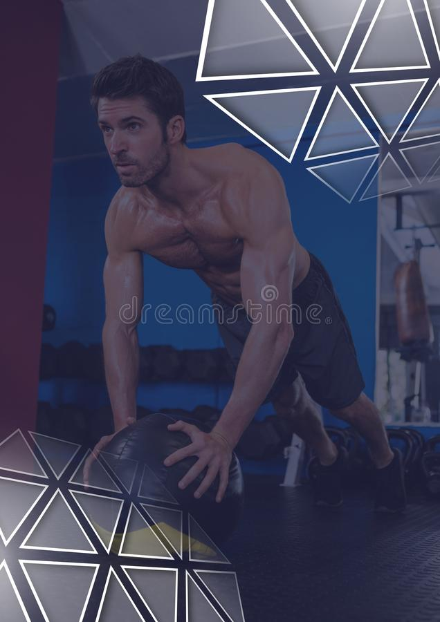 Athletic fit man in gym with triangle interface. Digital composite of Athletic fit man in gym with triangle interface stock image