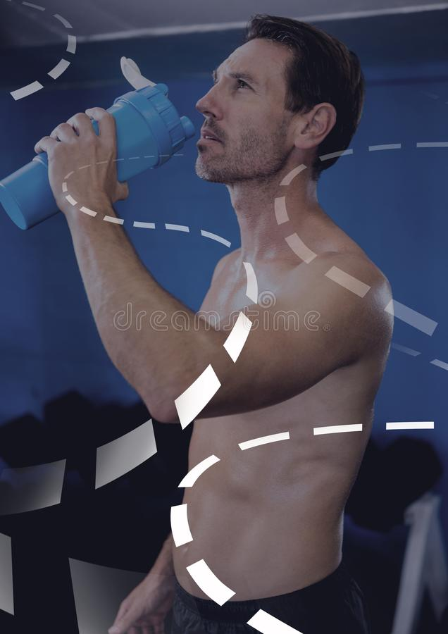 Athletic fit man rehydration water in gym with curved interface. Digital composite of Athletic fit man rehydration water in gym with curved interface stock photography
