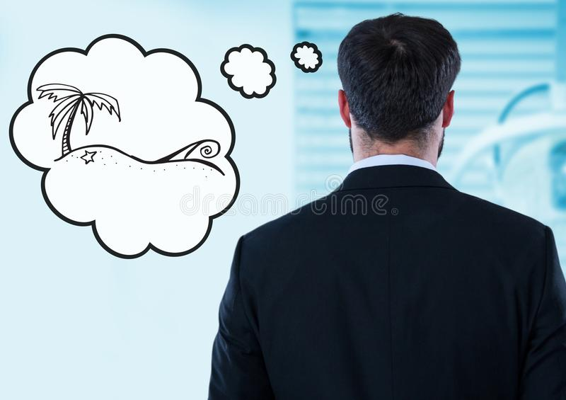 Back of business man dreaming of holiday against blurry blue room stock image