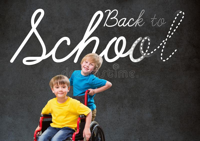 Back to school text on blackboard with disabled boy and friend in wheelchair stock image