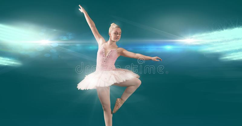 Ballet dancer dancing with sparkling beauty and light glowing royalty free stock photo