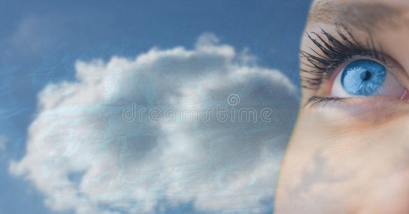 Blue eye dreaming and imagining in sky clouds. Digital composite of Blue eye dreaming and imagining in sky clouds royalty free stock images