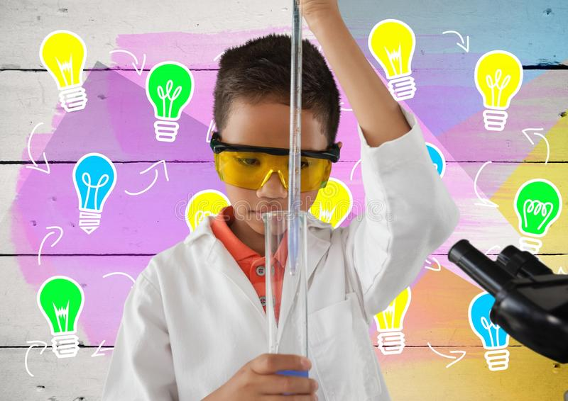 Boy scientist working in lab with colorful light bulb graphics stock images