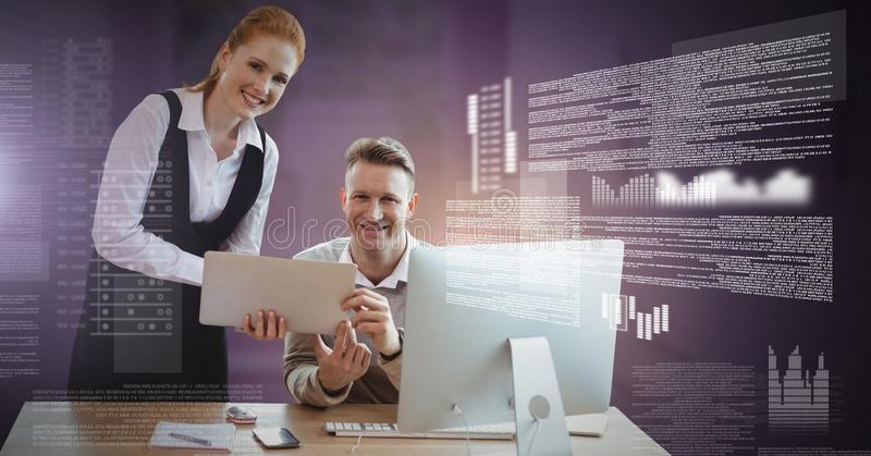 Business couple working on laptop with screen text interface royalty free stock photos