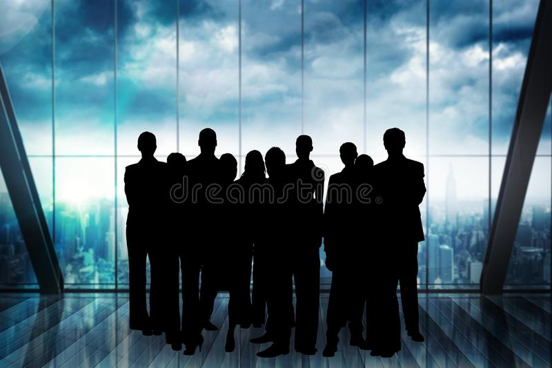 Business people silhouettes against building royalty free stock images