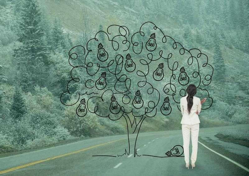 Business woman drawing a tree on the road stock photo