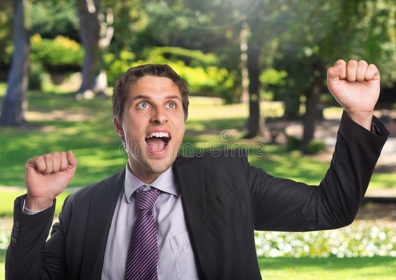 Businessman celebrating success in nature royalty free stock images