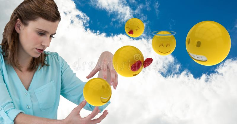 Digital composite of businesswoman with emojis against cloudy sky stock image