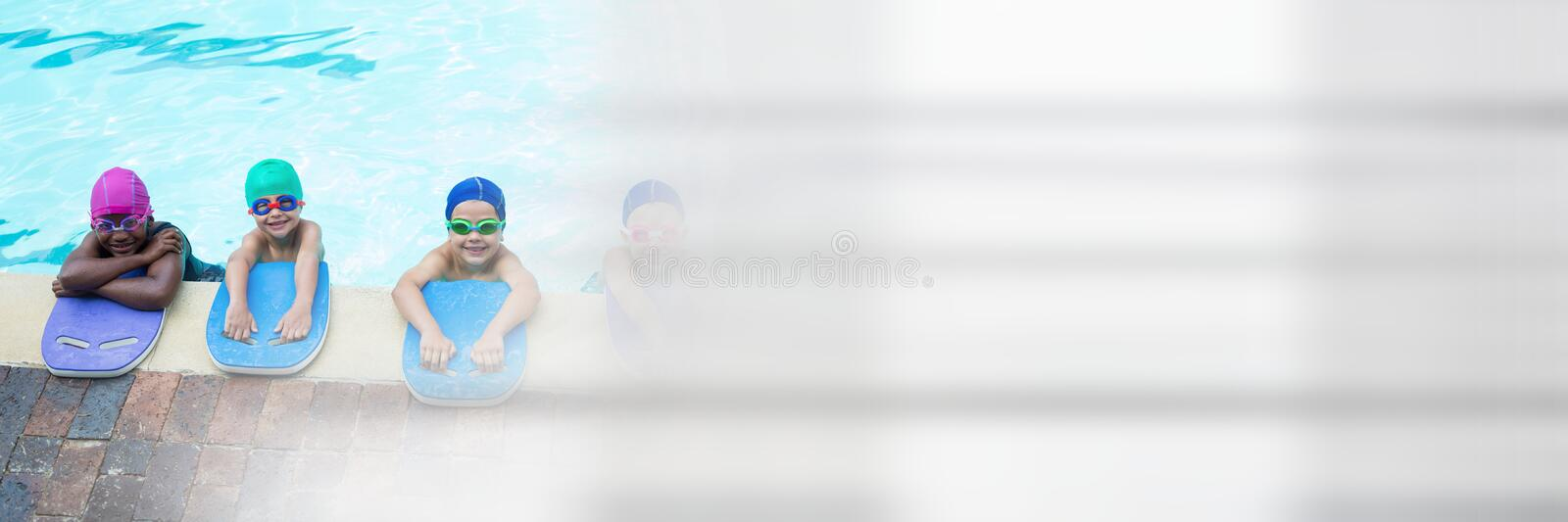Children learning to swim in Swimming pool with transition stock photography