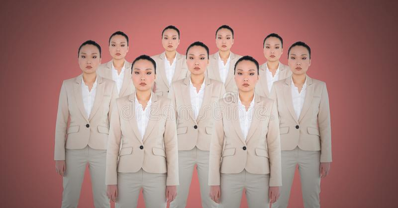 Clone women with pink background stock photo