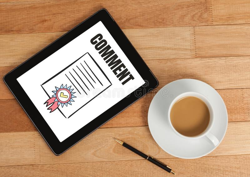 Comment text and certificate graphic on tablet screen royalty free stock images