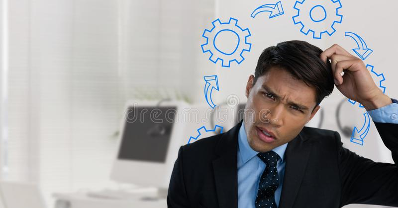 Confused man scratching his head and frowning surrounded by cogs. Digital composite of Confused man scratching his head and frowning surrounded by cogs stock photography