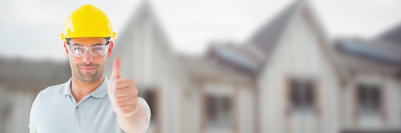 Construction Worker on building site giving thumbs up royalty free stock images