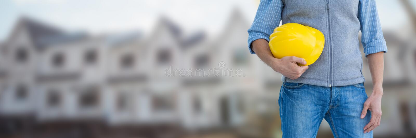 Construction Worker on building site holding helmet royalty free stock photos