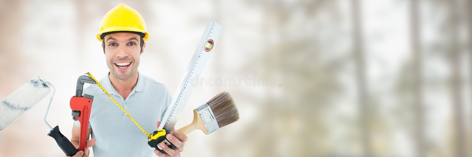 Construction Worker on building site with tools stock image