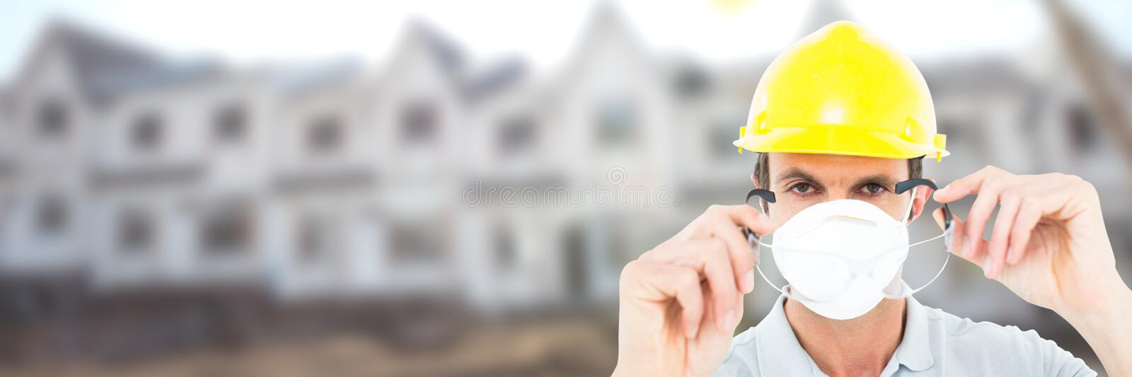 Construction Worker on building site wearing mask royalty free stock photography
