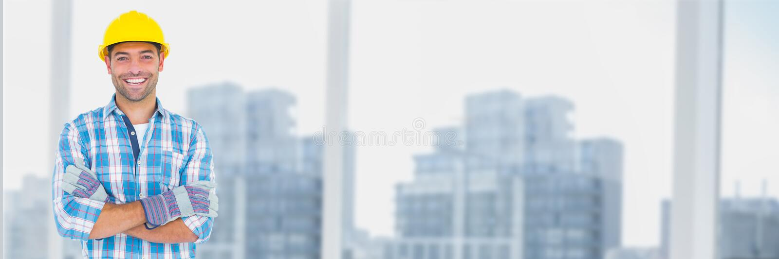 Construction Worker over city buildings stock images