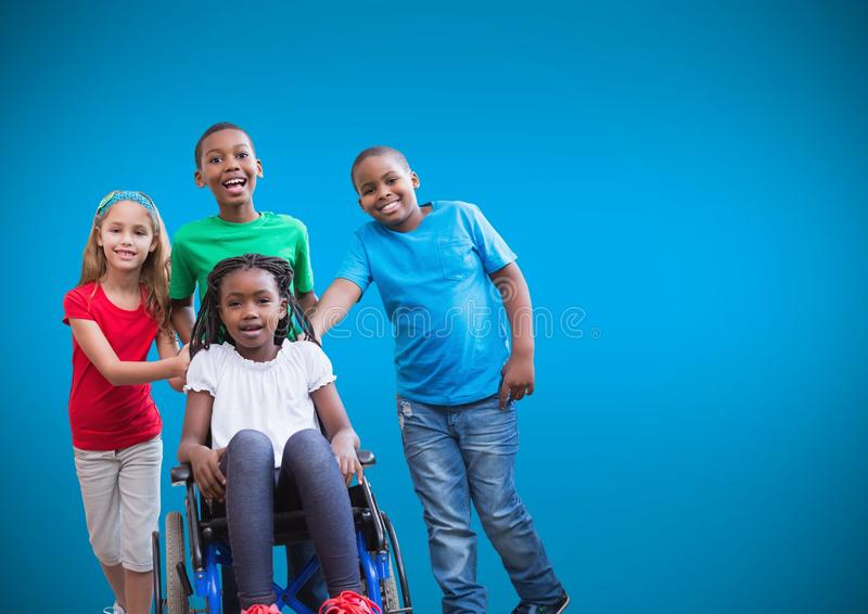 Disabled girl in wheelchair with friends and blue background stock images