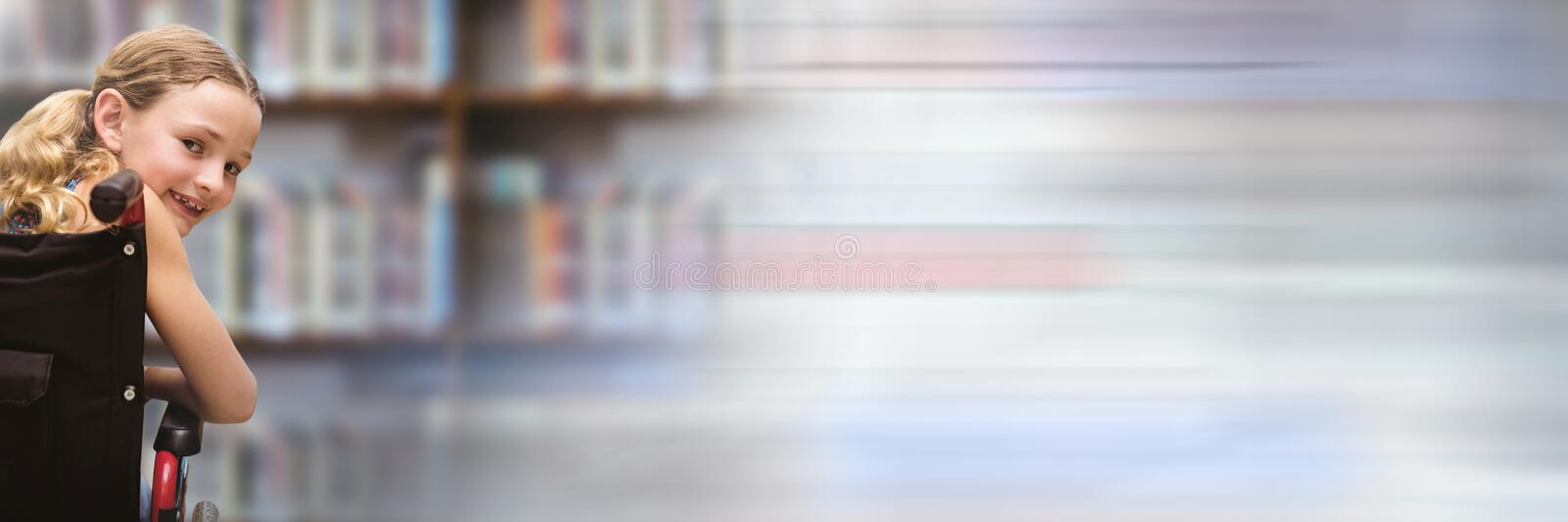 Disabled School girl in education library in wheelchair with transition stock photos