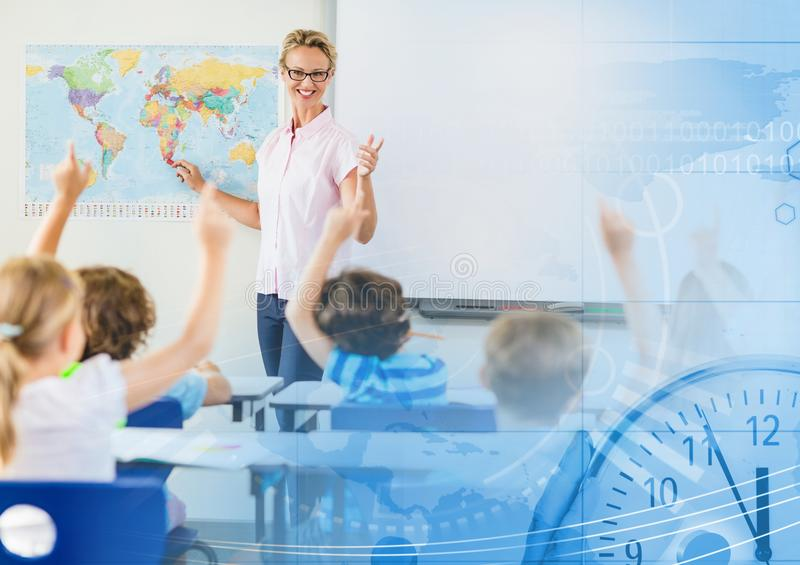 Elementary school teacher with class stock image