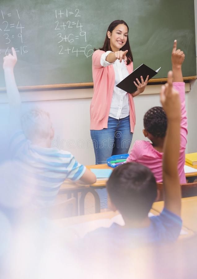 Elementary school teacher with class royalty free stock image