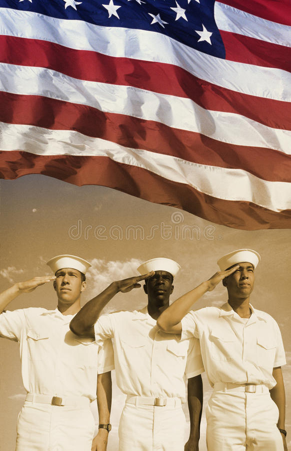 Digital composite: Ethnically diverse American sailors and American flag royalty free stock image