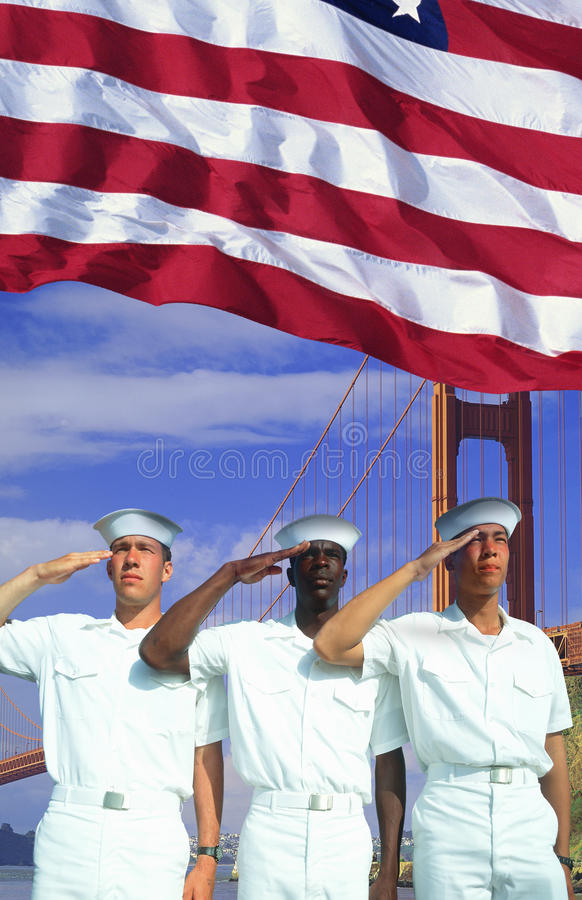 Digital composite: Ethnically diverse American sailors, American flag, Golden Gate Bridge royalty free stock photo