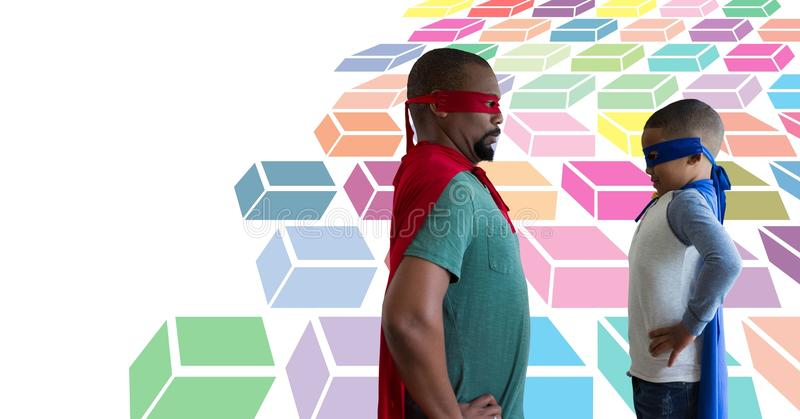 Father and son superheroes with colorful geometric pattern royalty free stock photos