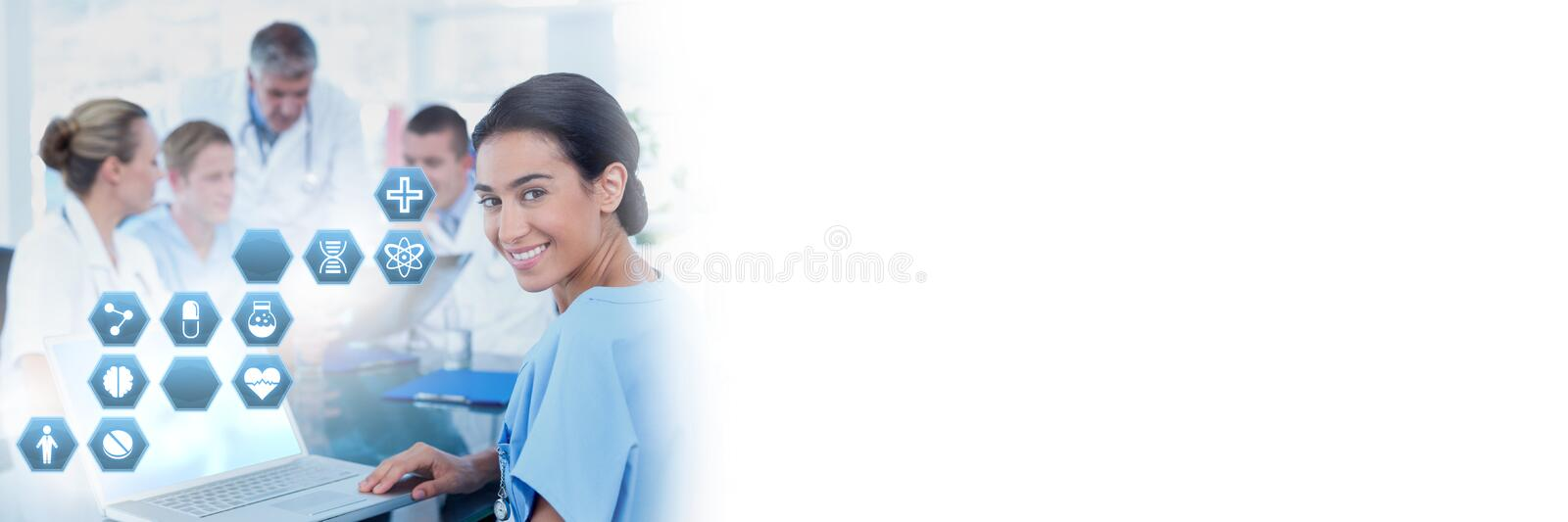 Female doctor holding tablet with medical interface hexagon icons royalty free stock photography