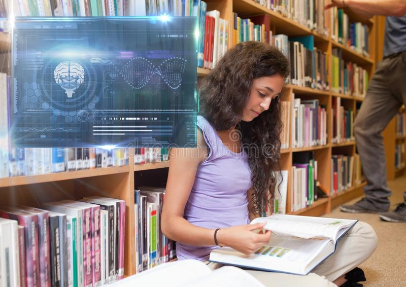 Female Student studying with book and science education interface graphics overlay royalty free stock photos