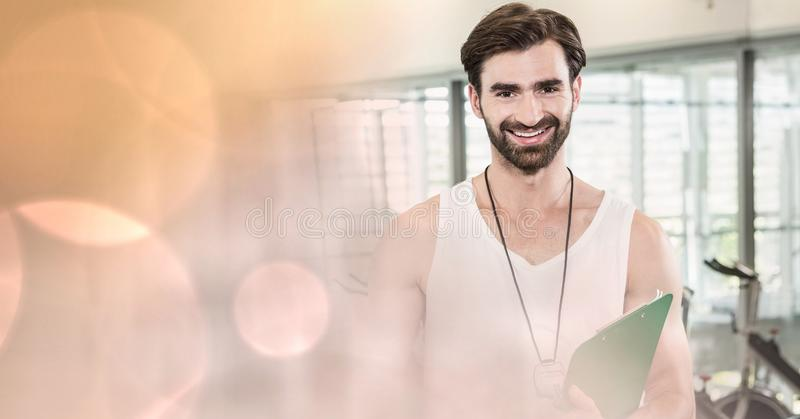 Fitness instructor smiling with bokeh in foreground stock photos