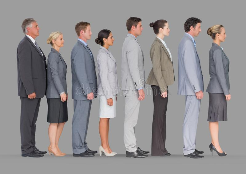Full body portrait of business people standing in line with grey background. Digital composite of Full body portrait of business people standing in line with stock photo