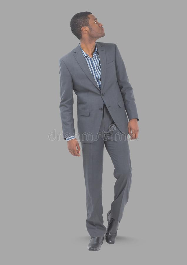Full body portrait of man standing with grey background royalty free stock photos