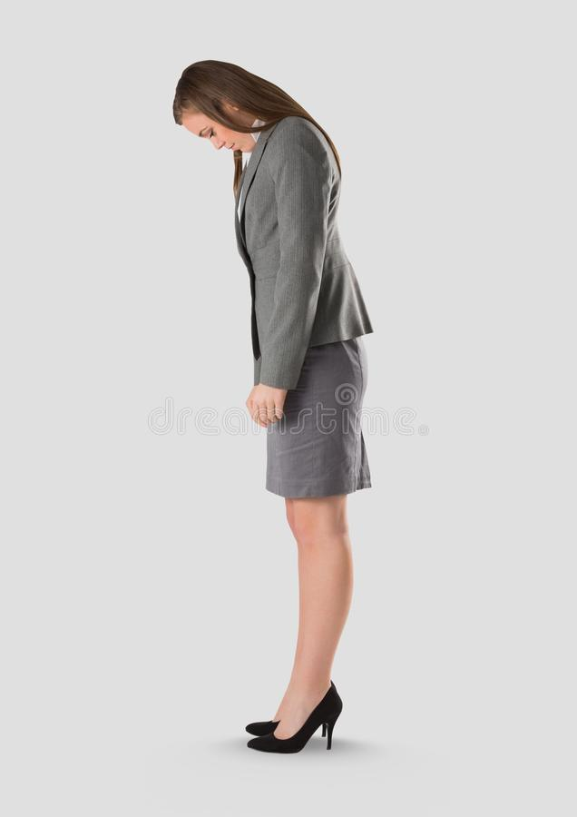 Full body portrait of woman standing with grey background. Digital composite of Full body portrait of woman standing with grey background royalty free stock images