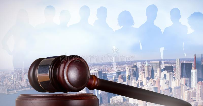 Gavel and people silhouettes over city royalty free stock images