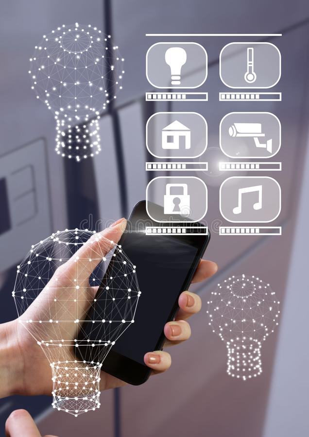 Hand holding phone with smart home interface and connectors royalty free stock photography