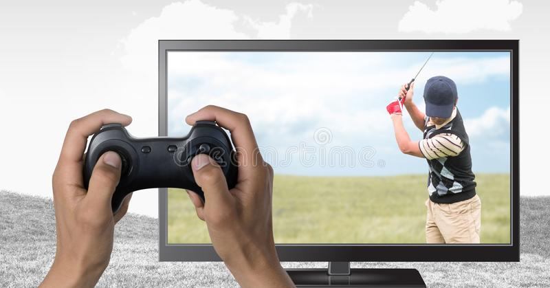 Hands holding gaming controller with golf player on television. Digital composite of Hands holding gaming controller with golf player on television royalty free stock photos