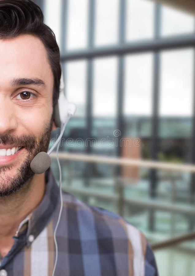 Happy customer care representative man against building background royalty free stock photo