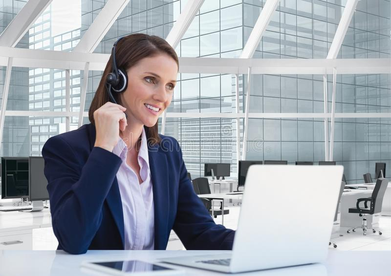 Happy customer care representative woman against office background royalty free stock photography
