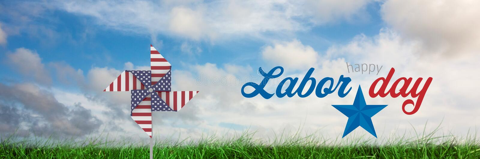 Happy labor day text and USA wind catcher in front of grass and sky royalty free stock photo