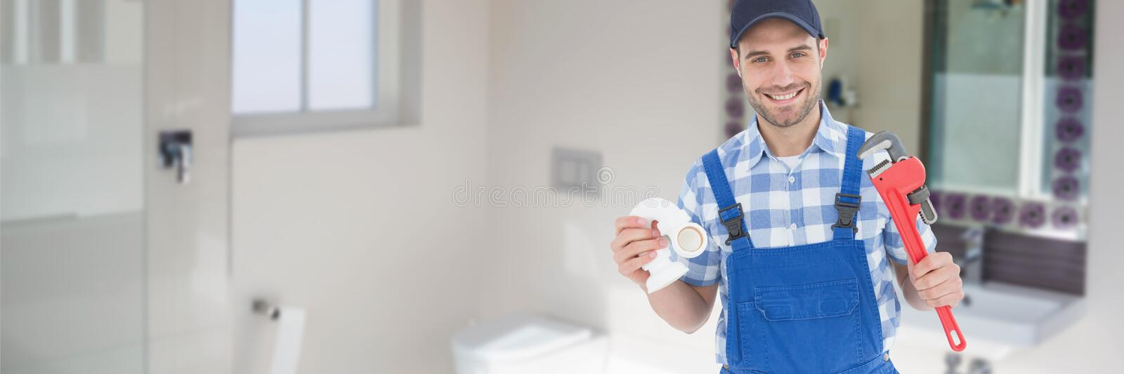 Happy plumber man holding a plunger and a wrench. Digital composite of Happy plumber man holding a plunger and a wrench royalty free stock image