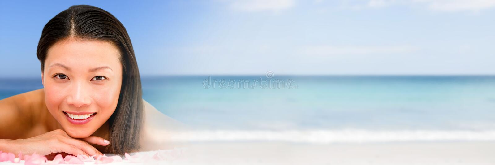 Happy spa woman relaxed with sea with transition stock photography