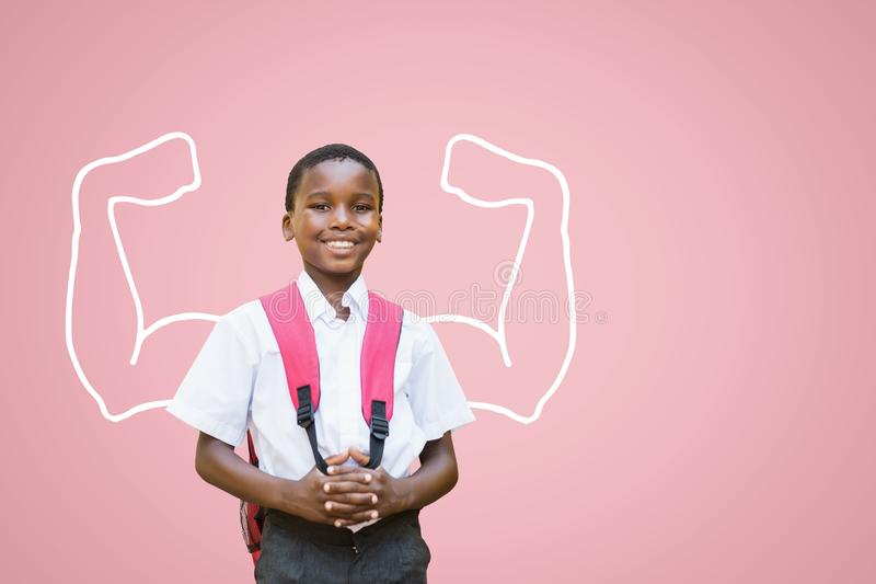 Happy student boy with fists graphic standing against pink background. Digital composite of Happy student boy with fists graphic standing against pink background stock photo